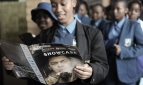 A government school student reads the Shakespeare Lives in Botswana Showcase programme photographer Monirul Bhuiyan v 2
